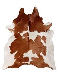 brown white cowhide rug