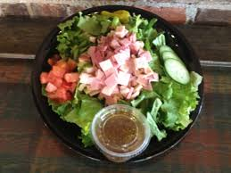 chef salad mixed lettuce tomatoes honey turkey honey ham provolone cheese and cubers served with your choice of dressing 7 29