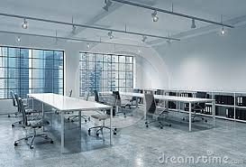 workplaces in a bright modern loft open space office empty tables and docents book shelves bright modern office space