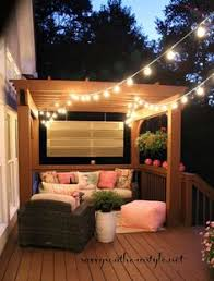 deck decorating ideas pergola lights and cement planters deck