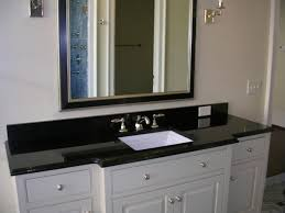 white bathroom cabinets with dark countertops. Single Sink Dark Countertop White Bathroom Cabinets Under Framed Mirror And Wallsconces In Painted With Countertops R