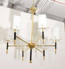 a vintage chandelier by stilnovo with a brass and black enameled and box form
