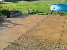 brown tiles stone Stained Concrete Patio floor with green plant on