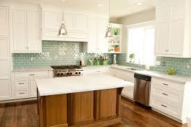 teal color subway tile kitchen
