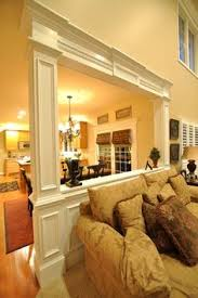 pony wall room divider trim with column for the entry area