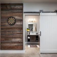 reclaimed wood wall panel sliding barn door in game room