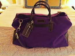 ... Weekend getaway T Anthony makes the perfect bag in the color purple 🐝 luggage  COACH Handbags ...