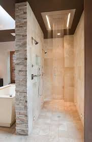 a long but narrow shower stall that has 12 inch square honed limestone on the floor