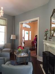 this view of the gracious seating area is a mirror image to the room across the hall seen in the before picture check out the stunning front door s fan