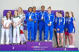 Cayman_s-gold-medalists-in-the-4x100m-freestyle-L-R-Jillian-Crooks,-Kyra-Rabess,-Alison-Jackson,- Avery-Lambert - Cayman Compass