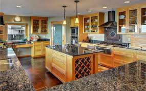 kitchen with glass door cabinets and baltic brown granite countertop