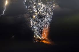 Towering Plumes Of Volcanic Smoke Mix With Streaks Of Lightning In