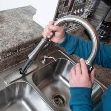 kitchen running the lines through the holes for new faucet installation faucet installation cost