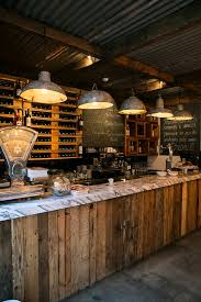 love the lighting and reclaimed lumber with marble top for bar ideas Vintage  ambiance in restaurant