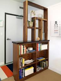 Apartment granite floor high bookshelves wooden armchair wooden floor  bookshelf room divider decorative plant round table