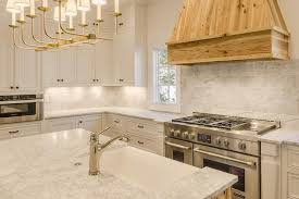 tt linear branched 10 light chandelier over kitchen island with sink