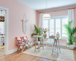 pink home office. inspiration for a mid-sized eclectic freestanding desk medium tone wood floor and brown pink home office n