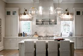 chandelier with clear glass globe shade over undermount sink kitchen island with seating full
