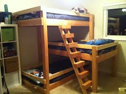 Wonderful Brown Varnished Triple Bunk Bed Feat Blue Cover Sheet ...