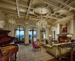 luxurious living room furniture. Ultra Luxurious Living Room Features Fine Detailed Ceiling With Crystalline Chandeliers Hanging Over Dark Hardwood Flooring Furniture