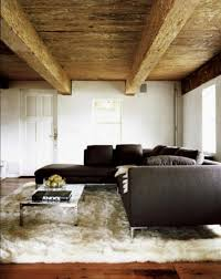 modern rustic living room with large white floakti rug