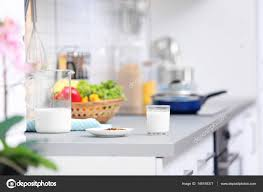 Kitchen counter with food Vegetables Plate With Dry Food And Milk Prepared For Cat On Kitchen Counter Stock Photo Depositphotos Plate With Dry Food And Milk Prepared For Cat On Kitchen Counter