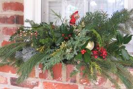 Make an outdoor window holiday swag using floral wire to fix things up.