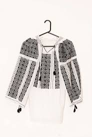 Romanian traditional white blouse with black embroidery. $120.00, via Etsy.