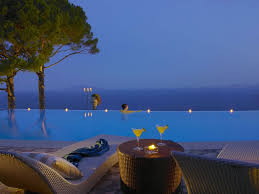 Modern Infinity Pool Night At Hotel Caesar Augustus Italy With Concept Design