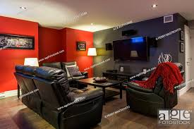 black leather sofas and reclining chair