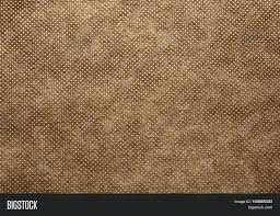 fabric sheet texture. a sheet of thick, coarsely woven fabric in brown colour.texture. texture e