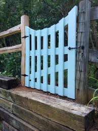 another colorful one learn how to make a wooden gate diy from the inadvertent farmer we love the curved feature on this garden gate