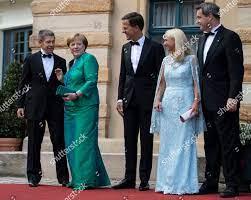 German Chancellor Angela Merkel 2L her ...