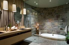 view in gallery ont bathroom with a sunken jacuzzi and a curved stone wall design lisa stevens