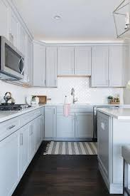 black and white stripe turkish fringe rug with gray cabinets
