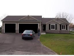 black garage doorblack shutters and garage door  Houses with Black Garage Doors