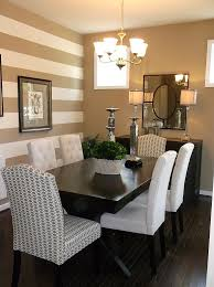 traditional dining room with a striped accent wall design anita roll murals