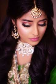 bride with soft pink makeup on enement