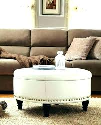 round coffee table with 4 ottomans