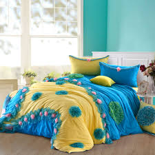 nautical spring girls bedroom with white wooden queen bed frame and blue yellow girls bedding with