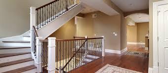 Upper Floor & Staircase Landing with dark wood vanity and beige wall