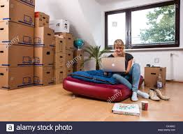 No Furniture Living Room Moving Boxes And Furniture In Living Room Stock Photo Royalty