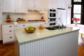 3of9recycled glass countertops give kitchens a distinctive speckled look this installation consists of sage green glass clear glasother of pearl in