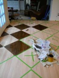 how to paint stain a pattern on a wood floor by artist arlene mcloughlin no directions attached paint entire floor base color then tape off paint