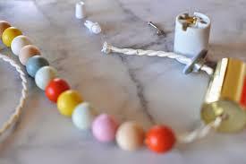 diy wooden bead pendant light tutorial
