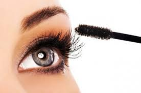 woman applying eyeshadow makeup