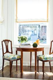 antique chairs with blue and green seat cushions