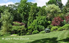 And there it is, hidden in plain sight alongside an open lawn, a leafy  screen of clipped shrubs, burgundy Japanese maples, and weeping willows  promising ...
