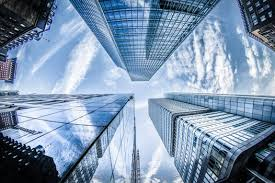 beautiful office buildings. Low-angle Photo Of Four High-rise Curtain Wall Buildings Under White Clouds  And Beautiful Office Buildings