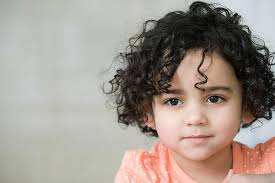 little with curly hair